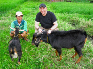 Andrew Kezeli with Farmer in Asia During Research Project